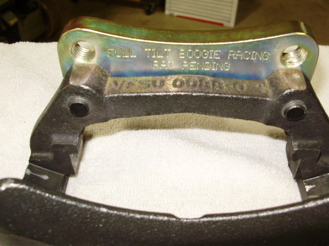 "S-197 13"" Conversion caliper bracket grind"